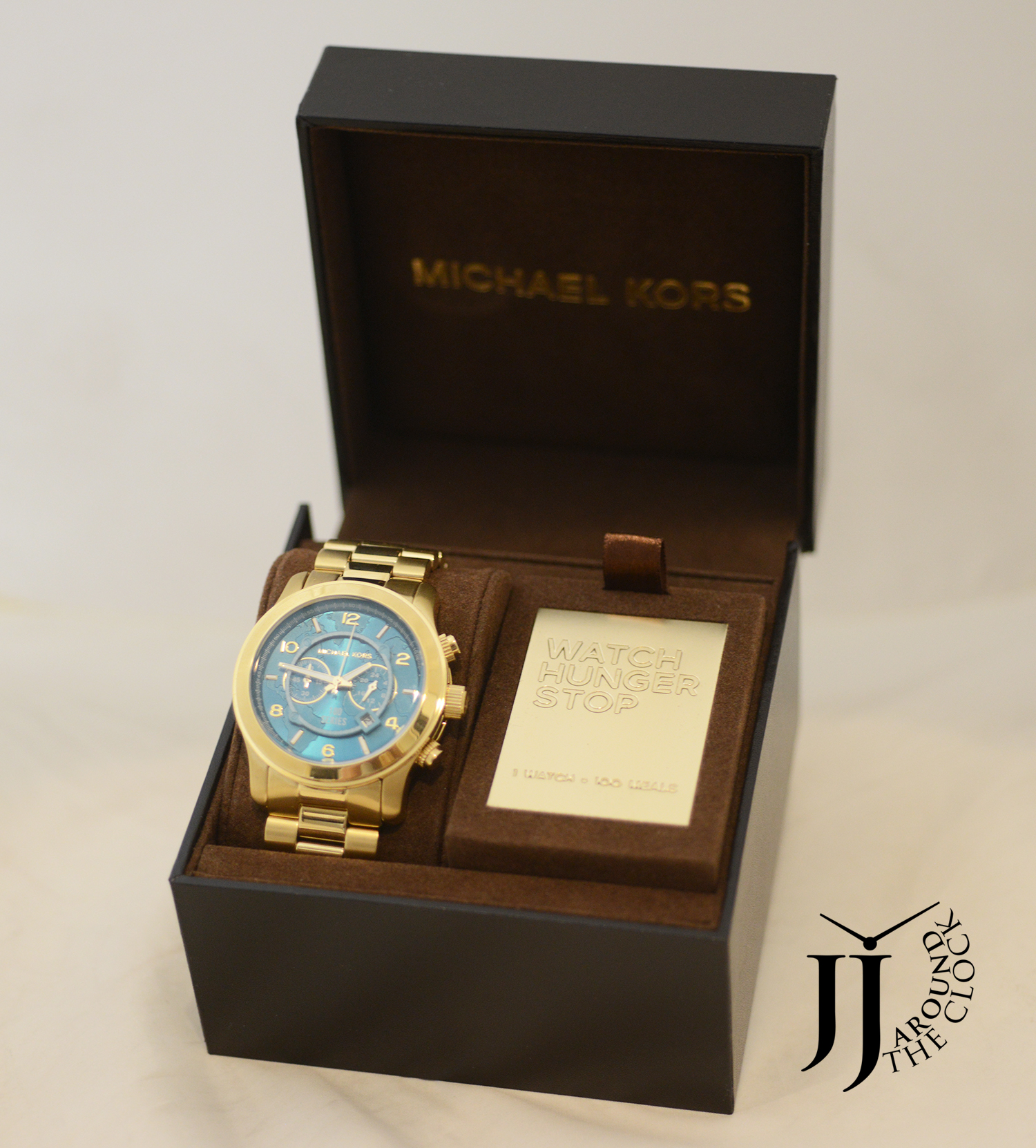 New michael kors runway gold tone hunger stop world map watch by michael kors imported gumiabroncs Images